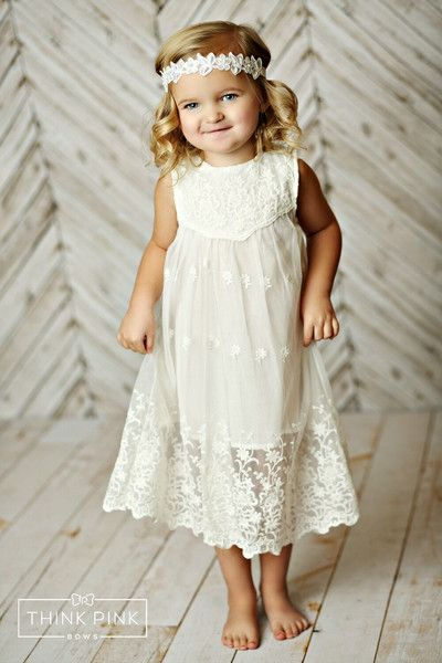 This vintage inspired lace dress has so many beautiful details. Made of soft and delicate lace in a stunning off-white color, the top of this cute flower dress features a beautiful floral fabric overlay. With its detailed hem, and crocheted details it perfectly balances elegance and playfulness. SHOP little girls clothing at http://thinkpinkbows.com/products/winter-fairy-lace-dress-white | Girls Dresses | Kids Fashion