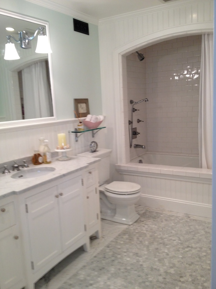#White #bathroom #remodels for under ten thousand dollars.  Prefab cabinet with Carrera marble top, recycled mirror, light fixture - lighting direct, toilet- home depot, bath fixtures- splurge waterworks, tile - copy yes of waterworks, lightest mint wall paint- think seafoam and then go X10 more subdued
