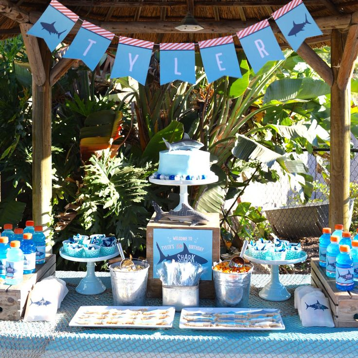 Shark birthday party. So many fun ideas for shark birthday party decorations, food, printables, & more! Get inspired with this amazing shark birthday party!