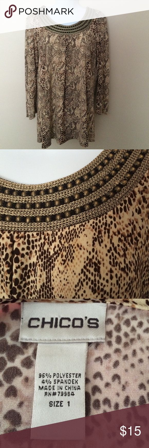 Chico's leotard top Pretty leopard print fun top has a beautiful neckline of embroidered collar w antique grommets   It's 3/4 sleeves great w dress pants or jeans worn a few times in excellent shape no tears stains.   Lovely Chico's Tops Tunics