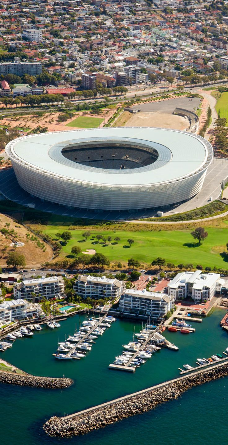 The cape Town Stadion near Indian Ocean in Cape Town, South Africa | Discover why Millions of Tourists visit South Africa