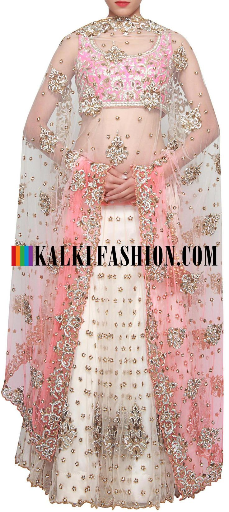 Buy Online from the link below. We ship worldwide (Free Shipping over US$100) http://www.kalkifashion.com/pink-and-white-lehenga-embellished-in-kundan-and-zari-embroidery-only-on-kalki.html