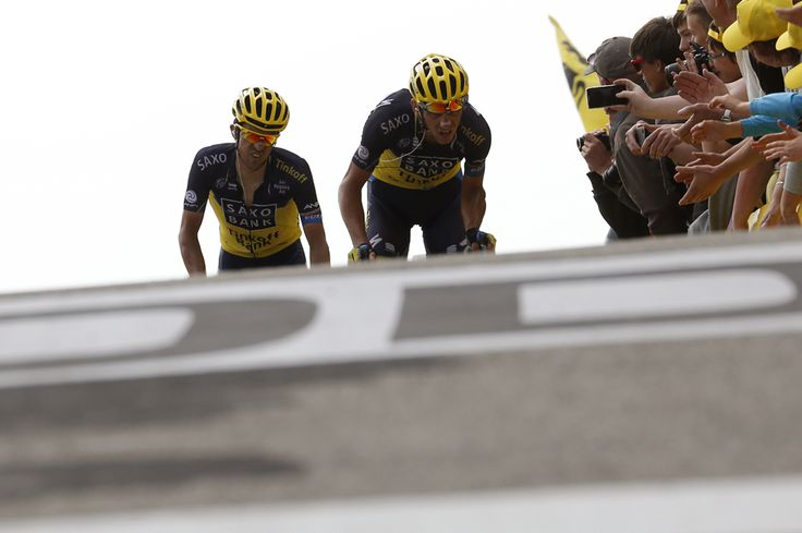 Spain's Alberto Contador, left, and his teammate Czech Republic's Roman Kreuziger grimace before crossing the finish line at the end of the 242.5 km fifteenth stage of the 100th edition of the Tour de France cycling race on July 14 between Givors and Mont Ventoux, southeastern France. (Jeff Pachoud/AFP/Getty Images) - See more at: http://www.boston.com/bigpicture/2013/07/tour_de_france_100th_edition_p_1.html#sthash.Lx9uVNEJ.dpuf