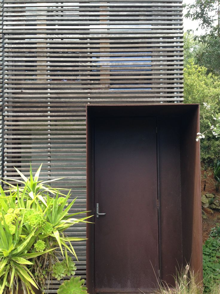 Timber battened cladding and rusted steel