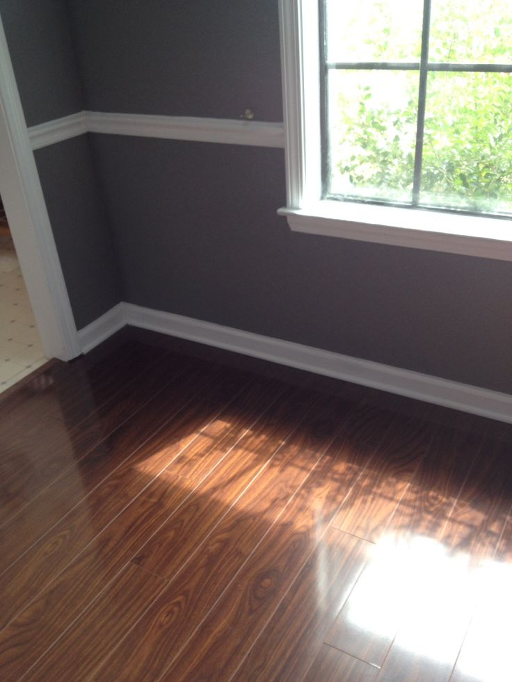 Seal Gray Paint With White Trim And Dark Laminate Floor