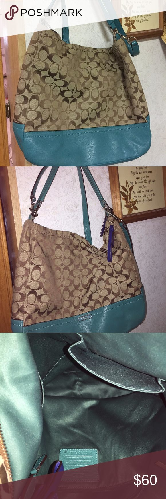 Womans Handbag Teal and  Brown Handbag in fair condition no wearing of handles or bottom of bag it has some wear on the top where it zips. I would say it is more of a larger bag Coach Bags Shoulder Bags
