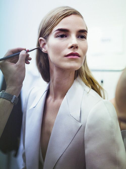 Suvi Koponen having her makeup touched up backstage at Calvin Klein Collection S/S 13