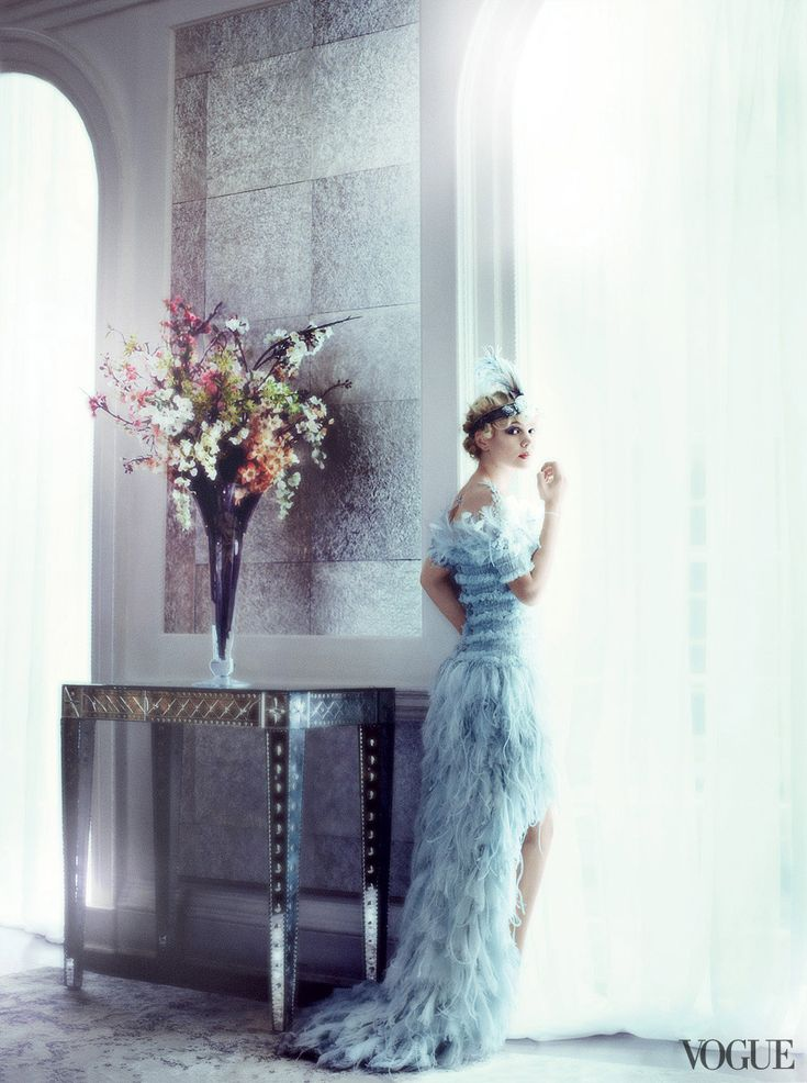 The last star to play Daisy on the big screen was Mia Farrow in 1974. Chanel Haute Couture chiffon, feather, and tulle dress with flouncing open shoulders. Twenties headband from New York Vintage.