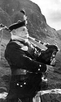 Old photograph of a Scottish Piper in Glencoe, Scotland