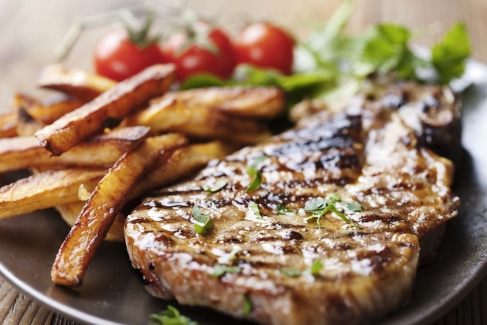 zesty garlic-lime marinade gives this #grilled pork chop recipe a ...