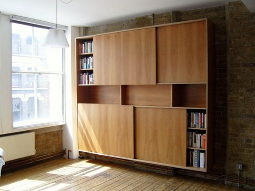 wooden bookcase with wooden sliding doors design