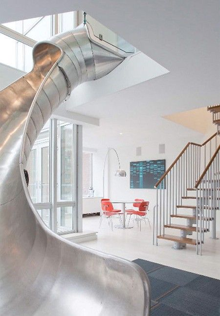 a slide inside....of course!!!! Who wants to take the stairs when you can slide!