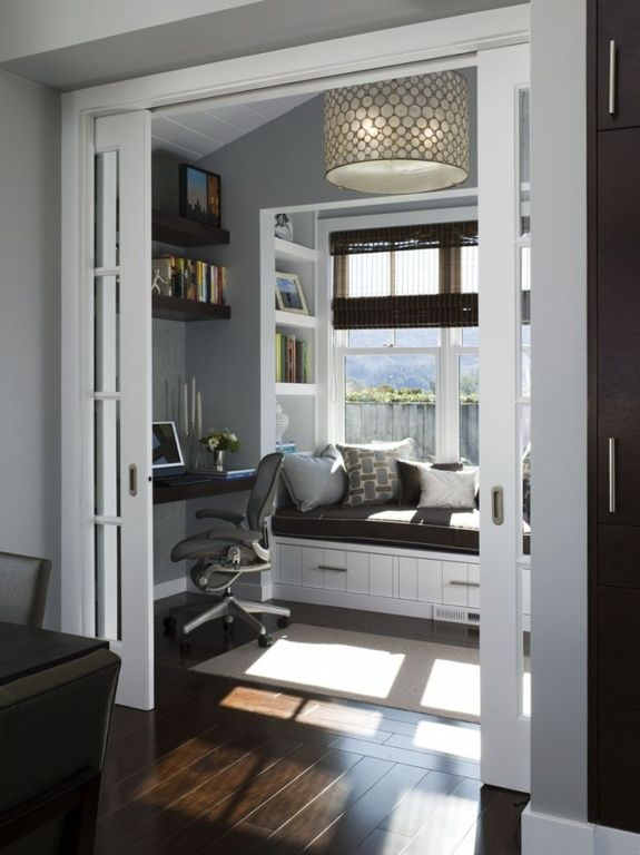 Traditional Home Office with Custom Cabinetry, Hardwood floors, Radiance matchstick rayon roman shade, Pendant light
