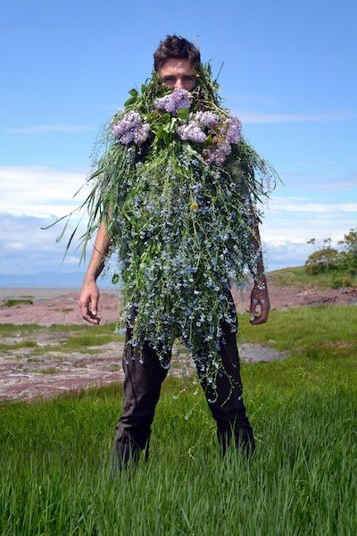 """""""Flowerbeard"""" (Quebec) by Matthew Cowan (An ongoing series of performative self-portraits with beard disguises constructed from local vegetation and flowers)."""