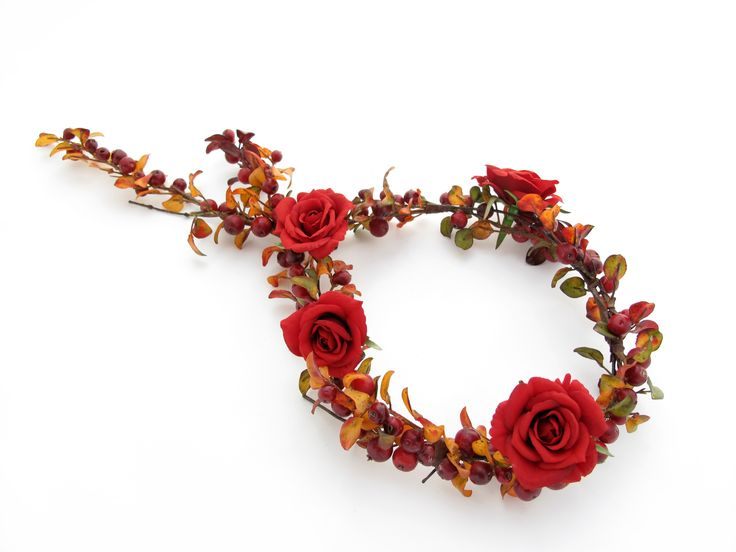 A circlet of autumn berries and red mini roses. Design your perfect wedding flowers online at www.lovelfowers.com.au