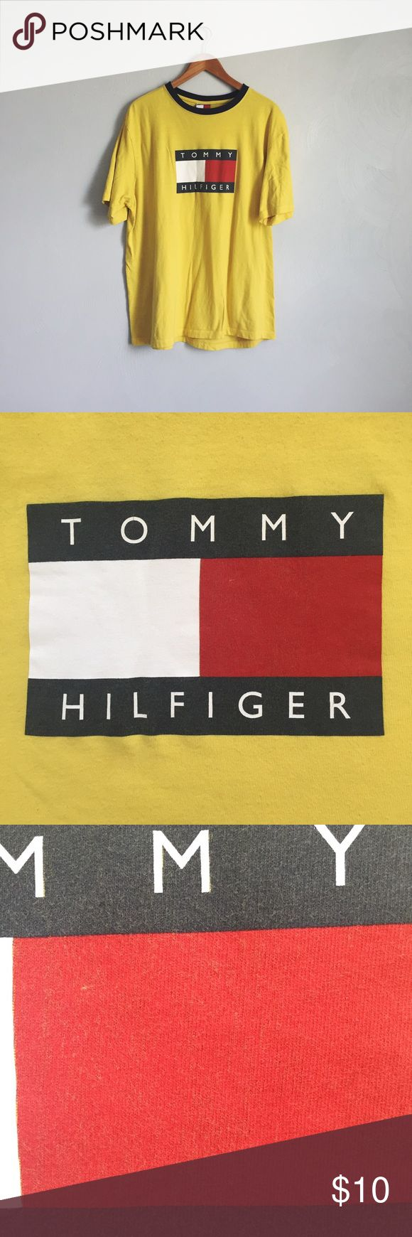 Tommy Hilfiger vintage yellow logo tee The 90's are back! Size medium in men's sizing so fits like a large for women. The logo graphic and the fabric is starting to get a bit fuzzy as shown in the close-up shots but otherwise no other flaws. Tommy Hilfiger Tops