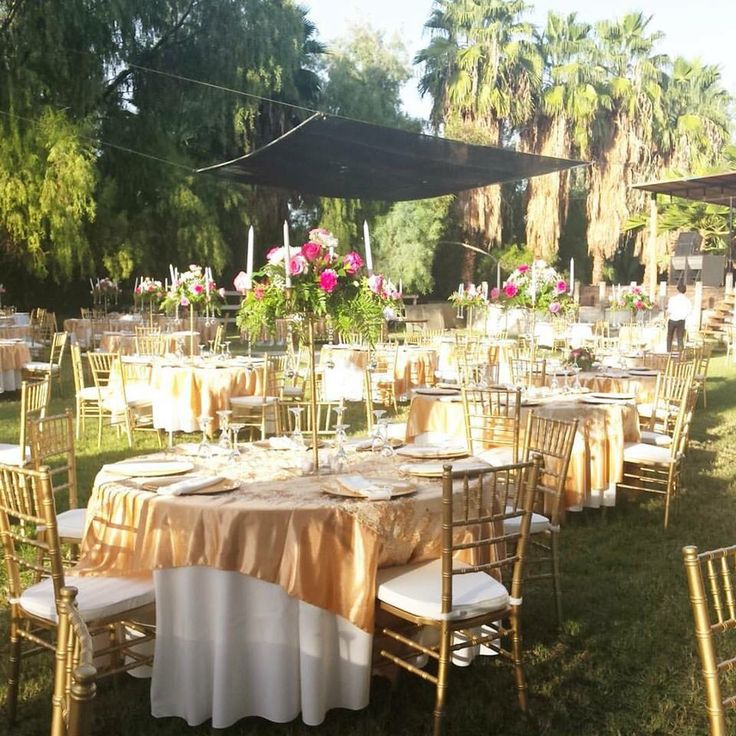 My beautiful Pink flower arrangements, gold and ivory tables.