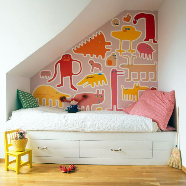 Graphic, bold and playful - great use of an unusually shaped wall.