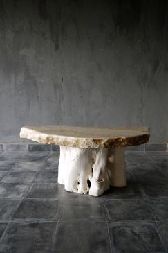 blaxsand - coffee table with natural onyx top on a root base