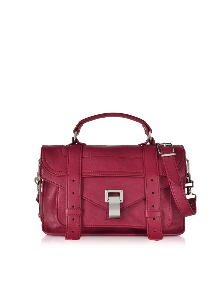 PS1 Tiny Fuchsia Lux Leather Satchel Bag crafted in soft, supple leather, is a tiny take on the iconic PS1 with all of the cool chic in a popping petite package. Featuring flap front with metal flip tab closure and leather straps detail, single handle and removable and adjustable shoulder strap, inner zip pocket, front pocket and signature brushed silver tone hardware detail. Signature dust bag included. Made in Italy.