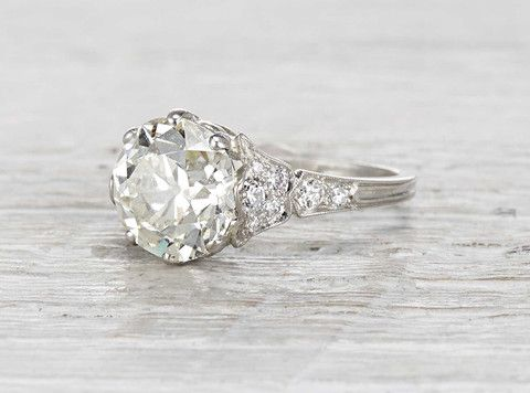 Vintage Edwardian engagement ring made in platinum and centered with a 3.93 carat GIA certified old European cut diamond with L color and VS1 clarity. Circa 1910.