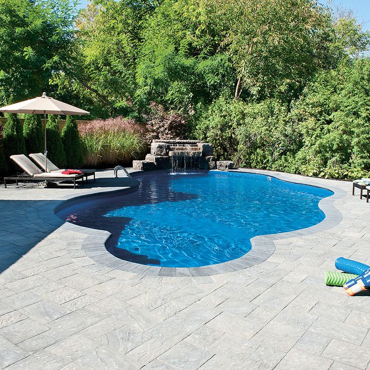 Poolside landscape. Project application using Ridgefield Plus pavers. Color: Ridgefield Plus Executive by Oaks Landscape Products.