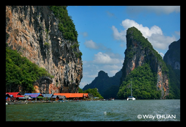 Koh Panyee, near Phuket, is indeed a touristic village, but anywhere in the world, places become famous for a reason. This is still a very unusual and interesting place to visit. The trick is that you don't have to be in the middle of a flock of tourists: go there early and you will be the only visitor in the village!  http://www.phuket101.net/2011/01/koh-panyi-village-phang-nga-bay-phuket.html