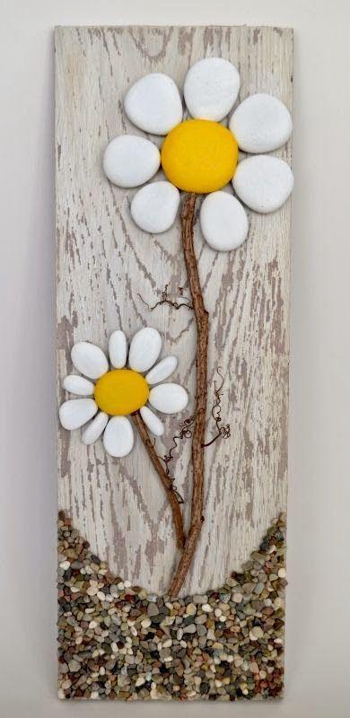 Pallet Art masterpiece. It's a rock art DIY project that's easy to make #flowers #rocks #art