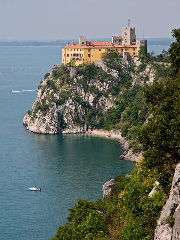 """Duino Castle on the Gulf of Trieste, Italy. (""""Rilke said later he had heard a voice calling to him as he walked near the cliffs, and he had used its words as the opening of the first Elegy: 'Wer, wenn ich schriee, hörte mich denn aus der Engel Ordnungen?'-'Who, if I cried out, would hear me among the angelic orders?' """")"""