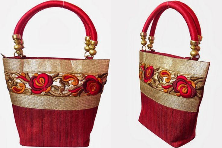 Moksh red floral  Hand Bag.To buy/0rder online http://www.maguvathefashionworld.com/2014/10/10-trendy-handbags-for-shopping.html#.VDwvIN3F8kN
