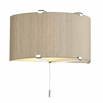 A stylish wall light with a polished chrome frame and a taupe silk shade. This comes with frosted diffusers at the top and bottom of the shade to gently wash the diffused light up and down the wall. Perfect as additional ambient lighting in living rooms and bedrooms. This light is double insulated, ensuring that it is safe to use in homes without an earth cable. This wall light comes complete with a pull cord switch for ease of use.