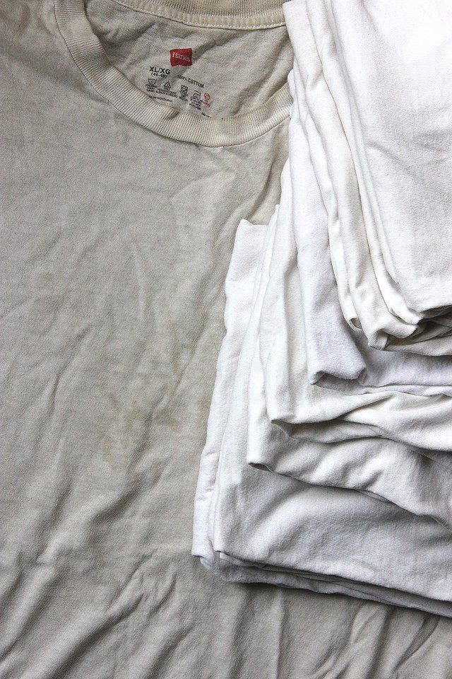Set the washer to the hottest setting. Put in the pile of offending whites. Added 1 regular scoop of laundry soap, 1/2 cup of Borax, and 1 cup of powdered dishwasher detergent. Let the laundry soak for 2 or 3 hours. Washed again, this time with laundry soap and bleach. Ta da!