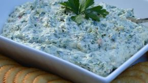 A no-cook version of artichoke dip is quick and easy to prepare with a food processor. Combine a sweet onion, canned artichoke hearts, spinach, and sour cream for a creamy and flavorful dip.