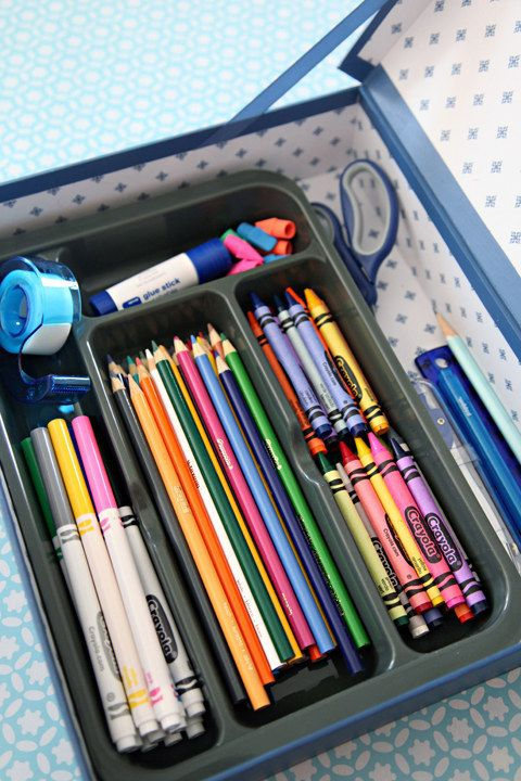Make a portable homework station by putting a dollar store utensil holder inside a document box.