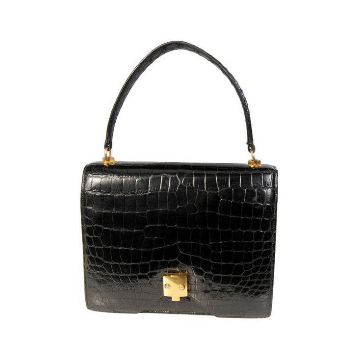 HermesVintage Black Crocodile Handbag | From a collection of rare vintage handbags and purses at https://www.1stdibs.com/fashion/accessories/handbags-purses/