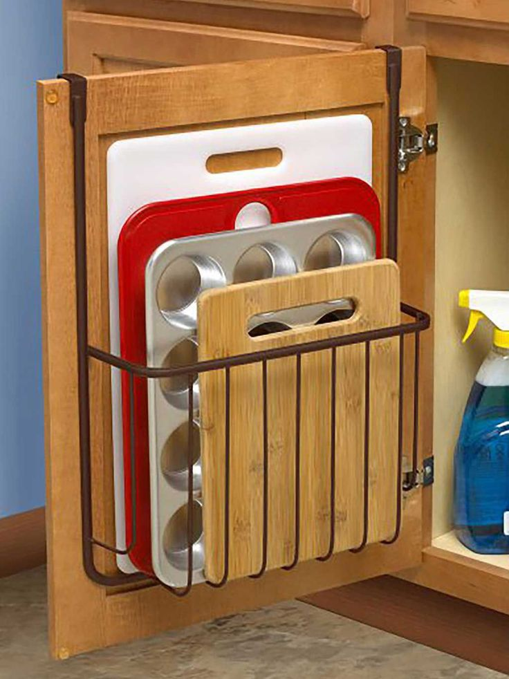 Over the Cabinet Cutting Board and Bakeware Holder Cabinet Door Organizer Find out more about update kitchen cabinets Diy Kitchen Storage, Kitchen Cabinet Organization, Home Organization Hacks, Home Decor Kitchen, Kitchen Furniture, Cabinet Organizers, Cabinet Ideas, Cabinet Storage, Organizing