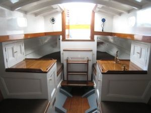Painted white with wainscotting? yes Please!   Sailboat Interior Ideas   Painting Sailboat Interior