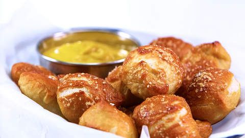 Soft Pretzel Bites | Who knew the difference between chewy golden pretzels and boiled dough was hiding in your fridge door? We did! Baking soda adds that quintessential tang and golden exterior to plain old pizza dough.