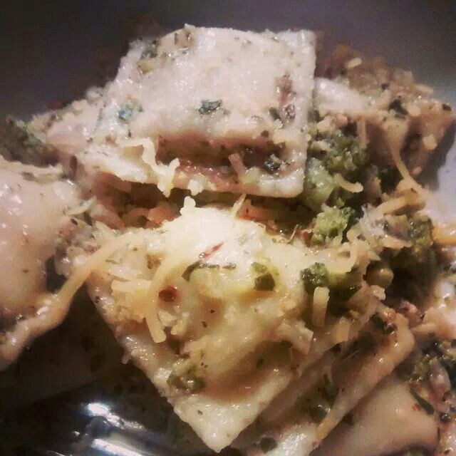Spinach and ricotta cheese stuffed ravioli in a garlic butter sauce ...