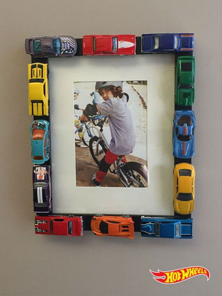 Line a picture frame with hot wheels.
