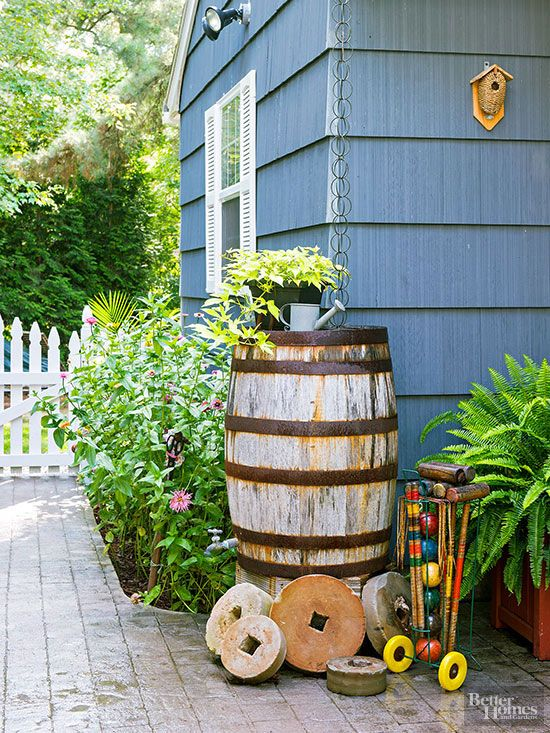 During drought, every drop of water is precious. Catch what you can every time it sprinkles with a rain barrel attached to your gutters. That way you can use the captured moisture to irrigate your garden instead of using valuable resources from your city water supply. In this garden, a rain chain channels runoff into a handsome wooden rain barrel. Note: Always check local regulations before installing a rain barrel. Believe it or not, some localities may ban them.
