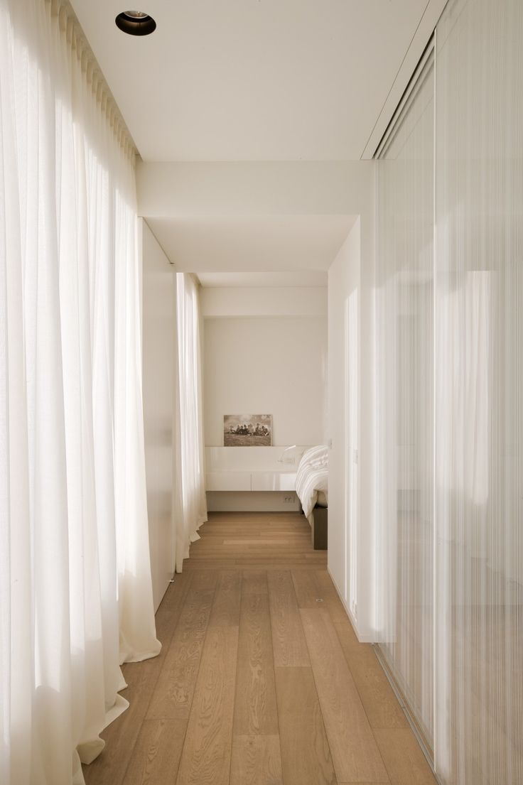 Love the soft light inside this corridor by Belgian interior designers iXtra.