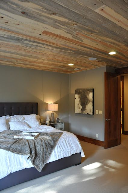 Sophisticated and clean rustic in a master bedroom with gray washed planks lining the ceiling. At House of Fifty blog