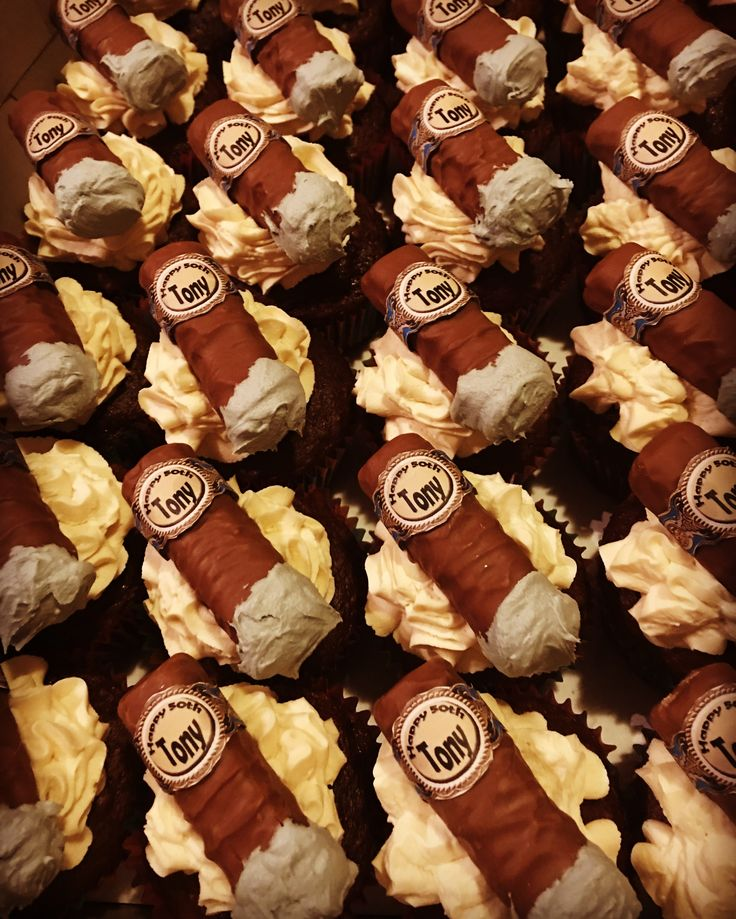 """Cafe Mocha cupcakes with """"Twix"""" cigar. Cake is sugarfree chocolate and coffee. Frosting is Khalua buttercream. Cigar is a custom paper wrap with gray colored buttercream as the cigar ash."""