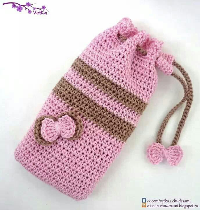Crochet pouch, only picture, no pattern. Notice how the drawstring is designed from slipping back .