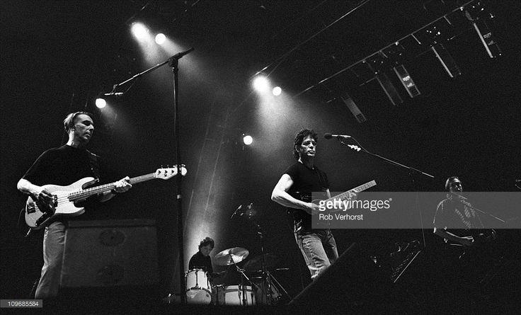 The Velvet Underground perform on stage at Ahoy, Rotterdam, 9th June 1993, L-R John Cale, Maureen Tucker, Lou Reed and Sterling Morrison.