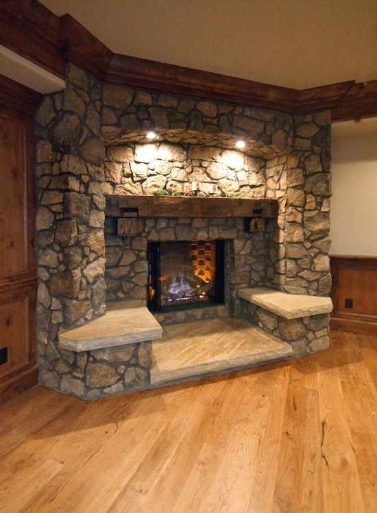 fireplace with places to sit…wonderful idea to make a room cozier and more efficient for entertaining.