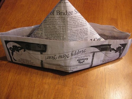 paper hats = My grandfather was the best at making these and telescoping palm trees with rolled newspaper.