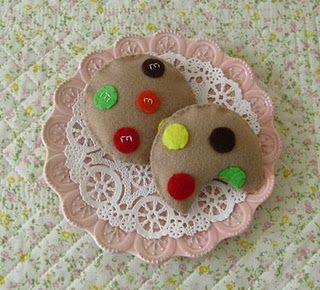 "Felt M Cookies;  I used an M hole punch on iron-on paper, and ironed on ""real"" Ms."