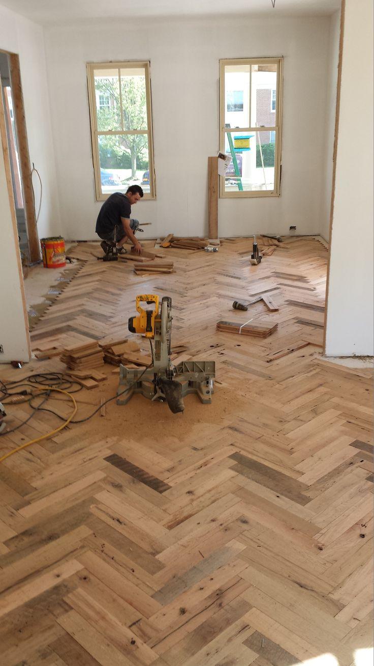 Installing our reclaimed Herringbone floors.